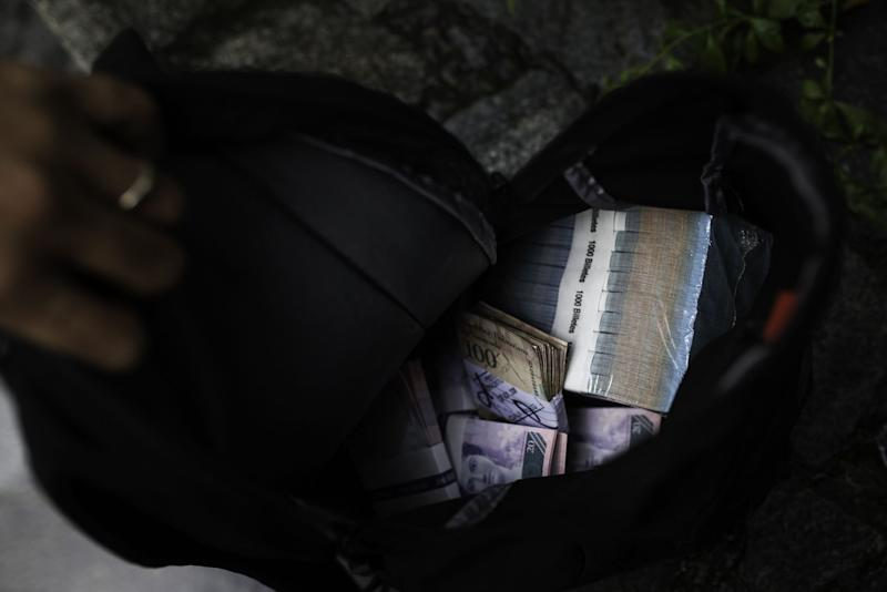 """(Bloomberg) -- After months looming in the background, Venezuela's black market is back.The difference between the black market price to buy dollars and the official rate is blowing out after months of relative stability. In just one week, the bolivar has depreciated 18% against the dollar on the streets where the currency is traded informally, now costing 10,130 bolivars, according to MonitorDolarVzla, which compiles the average of a myriad of sources. That compares with 7,336 bolivars at the official rate.After years of an artificially strong official rate, President Nicolas Maduro's government has overseen a dramatic devaluation in the past few years to essentially price the bolivar in line with the black market.To keep the relationship from gaping out again, the government implemented tight monetary requirements on banks earlier this year to keep bolivars on lock down at the central bank. The efforts were designed to drain liquidity and to keep local currency out of the hands of Venezuelans who typically swap them for dollars to retain purchasing power amid hyperinflation.While those controls are still in place, the gap is widening. Under the current exchange regime, Venezuela has swung drastically to become expensive in dollars.While the reason behind the sudden increase in price is unclear, some economists point to pressure built up from an overvalued bolivar and an increase in public spending.""""The currency wasn't depreciating at the same rate as inflation and now we're seeing that relationship normalize,"""" said Henkel Garcia, director of the Caracas-based consultancy Econometrica, who thinks the real value of the bolivar should be around 25,000 to 30,000 per dollar.\--With assistance from Alex Vasquez and Fabiola Zerpa.To contact the reporter on this story: Patricia Laya in Caracas at playa2@bloomberg.netTo contact the editor responsible for this story: Daniel Cancel at dcancel@bloomberg.netFor more articles like this, please visit us at bloomberg.com©2019 Blo"""