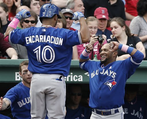 Toronto Blue Jays' Edwin Encarnacion (10) is greeted by teammate Emilio Bonifacio after hitting a home run against the Boston Red Sox during the fifth inning of a baseball game at Fenway Park in Boston, Sunday, May 12, 2013. (AP Photo/Winslow Townson)