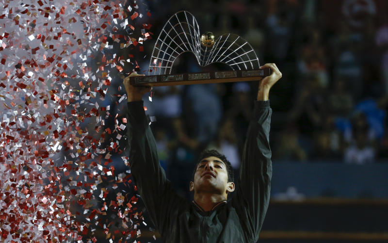 Chile's Cristian Garin holds up his trophy after winning the final match of the Rio Open tennis tournament against Italy's Gianluca Mager in Rio de Janeiro, Brazil, Sunday, Feb. 23, 2020. (AP Photo/Luciano Belford)