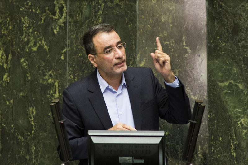Iranian Minister for Science, Research and Technology, Reza Faraji Dana, addresses the parliament during his impeachment process in Tehran on August 20, 2014