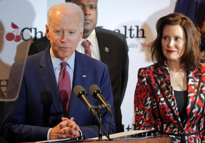 Democratic U.S. presidential candidate and former Vice President Joe Biden speaks next to Michigan Governor Gretchen Whitmer during a campaign stop at Cherry Health clinic in Grand Rapids, Michigan, U.S., March 9, 2020. (Brendan McDermid/Reuters)