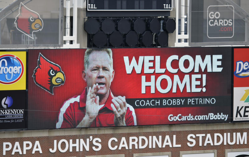 A sign posted on the scoreboard of Papa John's Cardinal Stadium welcomes the return of Bobby Petrino as the Louisville Cardinals new head football coach Thursday, Jan. 9, 2014, in Louisville, Ky. (AP Photo/Timothy D. Easley)