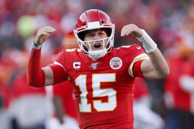 Kansas City Chiefs' Patrick Mahomes reacts after throwing a touchdown pass to Tyreek Hill during the first half of the NFL AFC Championship football game against the Tennessee Titans Sunday, Jan. 19, 2020, in Kansas City, MO. (AP Photo/Charlie Neibergall)