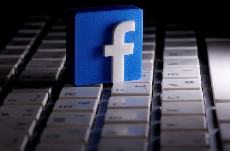 FILE PHOTO: FILE PHOTO: A 3D-printed Facebook logo is seen placed on a keyboard in this illustration