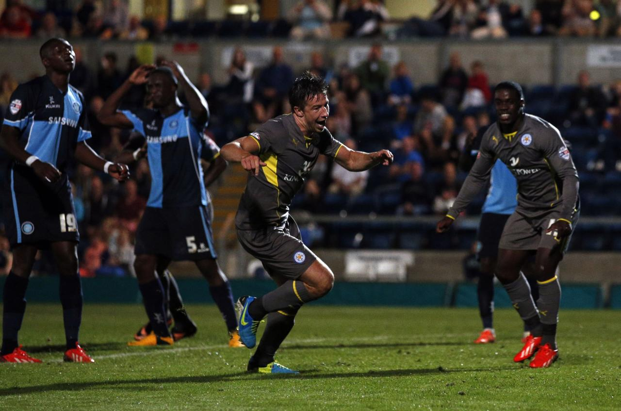 Leicester's Sean St. Ledger-Hall (centre) celebrates scoring the winning goal during the Capital One Cup, First Round match at Adams Park, Wycombe.