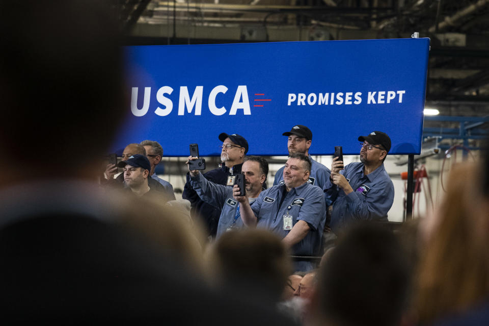 WARREN, MI - JANUARY 30: Employees record with their phones as President Donald Trump speaks during a visit to Dana Incorporated, an auto-manufacturing supplier, on January 30, 2020 in Warren, Michigan. During his speech Trump touted good job numbers and the strong performance of car companies in the state. (Photo by Brittany Greeson/Getty Images)