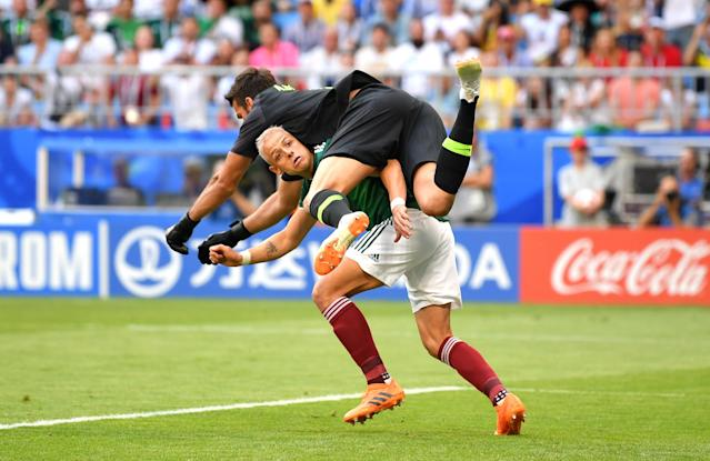 <p>Javier Hernandez of Mexico collides with Alisson of Brazil as they compete for the ball during the 2018 FIFA World Cup Russia Round of 16 match between Brazil and Mexico at Samara Arena on July 2, 2018 in Samara, Russia. (Photo by Dan Mullan/Getty Images) </p>