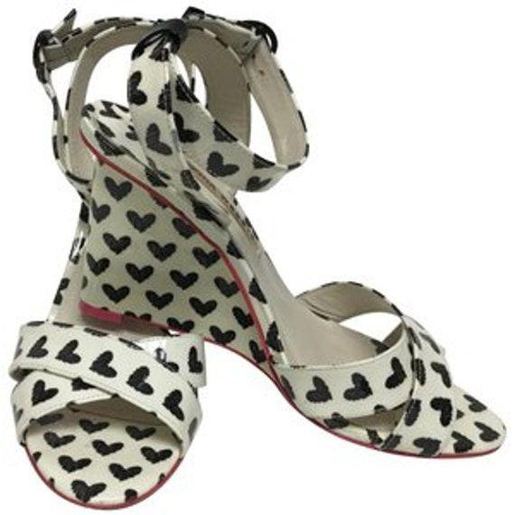 """<p><strong>Sophia Webster</strong></p><p>leprix.com</p><p><strong>$18.00</strong></p><p><a href=""""https://leprix.com/shop/sophia-webster/mules/sophia-webster-black-and-white-amanda-print-heart-patent-wedges-size-eu-385-approx-us-85-regular-m-b-item-24992645"""" rel=""""nofollow noopener"""" target=""""_blank"""" data-ylk=""""slk:Shop Now"""" class=""""link rapid-noclick-resp"""">Shop Now</a></p><p>If you have a specific designer piece that you've had your eye on for forever, then <a href=""""https://leprix.com/"""" rel=""""nofollow noopener"""" target=""""_blank"""" data-ylk=""""slk:LePrix"""" class=""""link rapid-noclick-resp"""">LePrix</a> is the perfect website for you. Their inventory is HUGE and they have some great designer products with super low price tags.</p>"""
