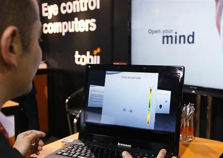 A Tobii Technology representative demonstrates what the Swedish company says is the world's first first eye-controlled laptop at the Consumer Electronics Show in Las Vegas