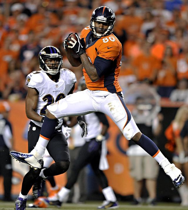 Denver Broncos tight end Julius Thomas (80) pulls in a pass that he ran in for a touchdown as Baltimore Ravens free safety Michael Huff (29) defends during the first half of an NFL football game, Thursday, Sept. 5, 2013, in Denver. (AP Photo/Jack Dempsey)