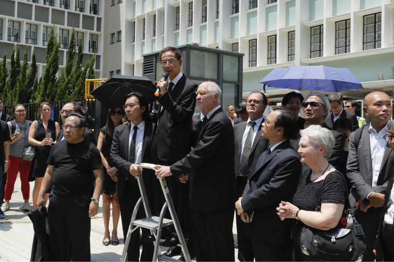 """Veteran democracy activist Martin Lee, center, speaks during a protest march by lawyers in Hong Kong, Wednesday, Aug. 7, 2019. The head of Beijing's Cabinet office responsible for Hong Kong says the territory is facing its """"most severe situation"""" since the handover from British rule in 1997. (AP Photo/Kin Cheung)"""