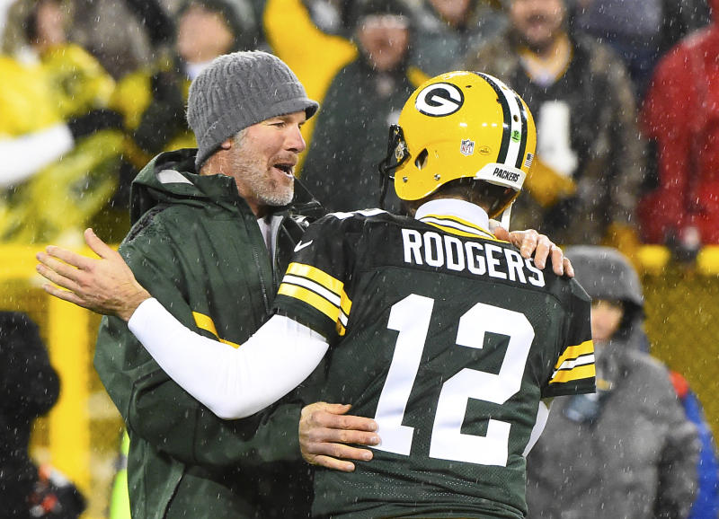 Nov 26, 2015; Green Bay, WI, USA; Green Bay Packers former quarterback Brett Favre hugs Green Bay Packers quarterback Aaron Rodgers (12) at half time for a NFL game against the Chicago Bears on Thanksgiving at Lambeau Field. Mandatory Credit: Mike DiNovo-USA TODAY Sports