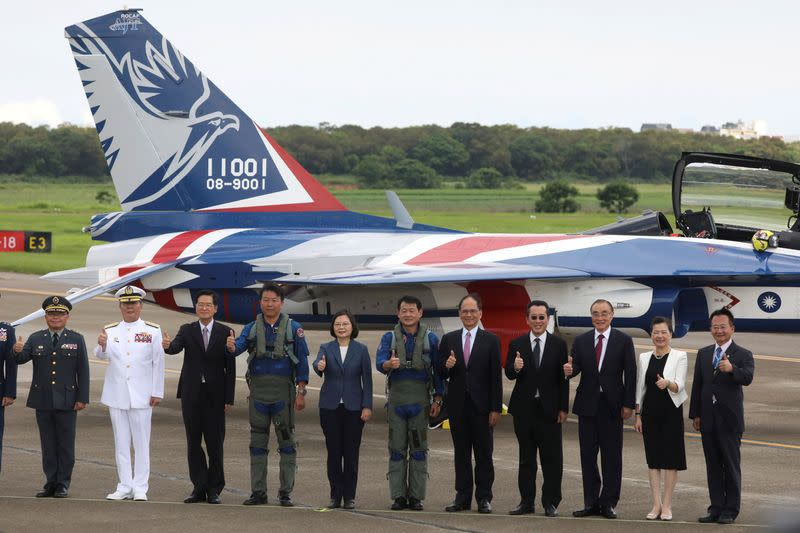 Taiwanese President Tsai Ing-Wen poses for a photo in front of the AIDC T-5 Brave Eagle, Taiwan's first locally manufactured advanced jet trainer, in Taichung