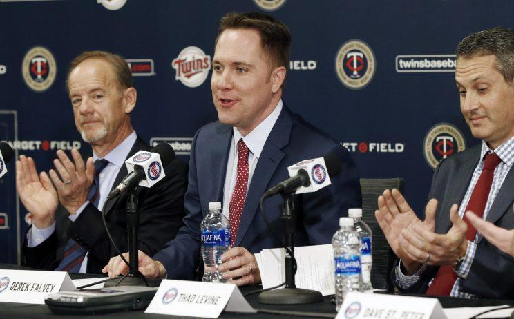 Derek Falvey, middle, is the 33-year-old leader of the Minnesota Twins. (AP)
