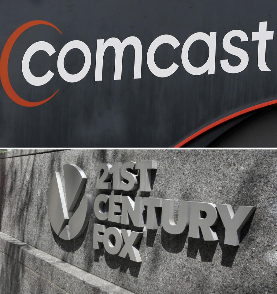 FILE- This combo of file photos shows the 21st Century Fox sign outside of the News Corporation headquarters building on Aug. 1, 2017, in New York, bottom, and a Comcast sign on Oct. 12, 2017, in Hialeah, Fla. A person familiar with Comcast's thinking says the cable company is no longer in discussions to buy pieces of 21st Century Fox. This person was not permitted to discuss the matter for the record. (AP Photo/File)