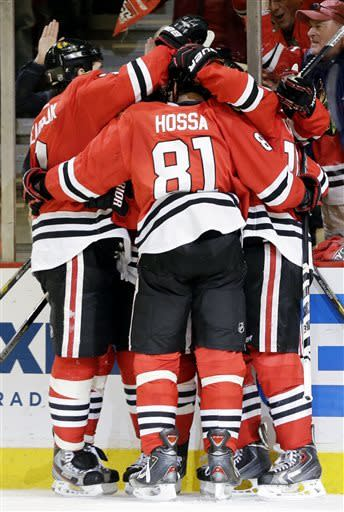 Chicago Blackhawks' Andrew Shaw celebrates with teammates after scoring a goal during the second period of Game 5 of the NHL hockey Stanley Cup playoffs Western Conference semifinals against the Detroit Red Wings in Chicago, Saturday, May 25, 2013. (AP Photo/Nam Y. Huh)
