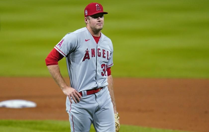 Los Angeles Angels relief pitcher Ty Buttrey reacts after giving up a solo home run to Colorado Rockies' Ryan McMahon.