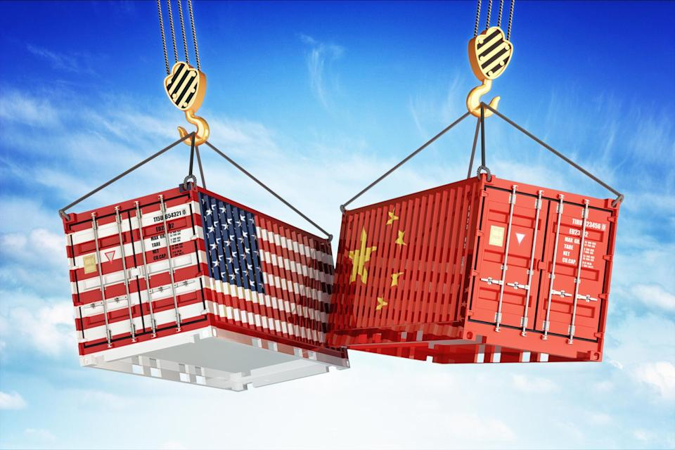 Shipping containers painted with U.S. and China flags.