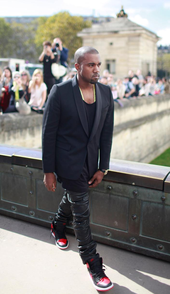US rap artist Kanye West arrives for the presentation of Christian Dior's ready to wear Spring-Summer 2013 collection, in Paris, Friday, Sept.28, 2012. (AP Photo/Thibault Camus)