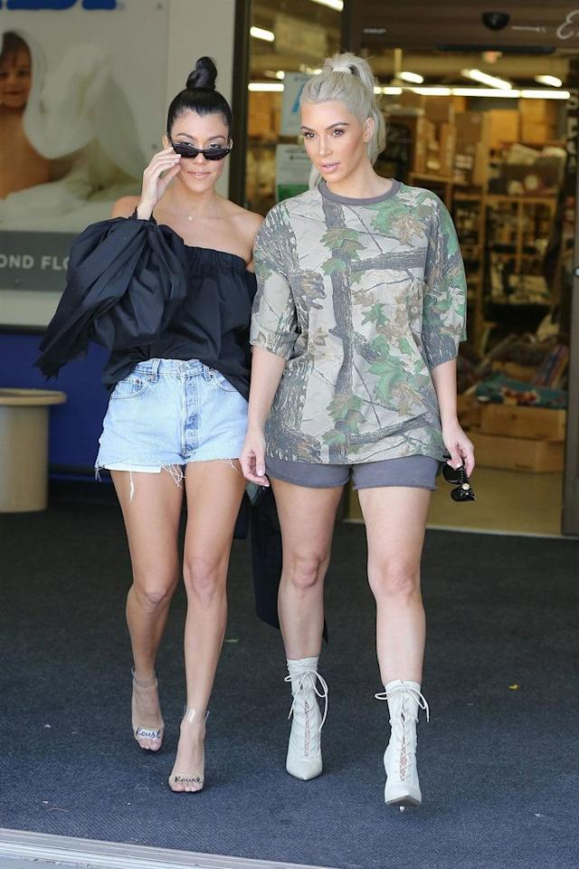 "<p><strong>When: Oct. 9, 2017 </strong><br />Earlier that day, Kim and Kourtney <a rel=""nofollow"" href=""https://ca.style.yahoo.com/kim-kourtney-kardashian-baby-shopping-151500831.html"">were spotted shopping at Buy Buy Baby in Calabasis, Calif.</a>, wearing super short shorts. Kim pulled her hair into a high ponytail and paired her grey shorts with a print top and white lace-up booties. Meanwhile, sister Kourtney paired denim cutoffs with a black Milly off-the-shoulder blouse, oversized glasses, her signature topknot, and clear ""Kourt"" heels. </p>"