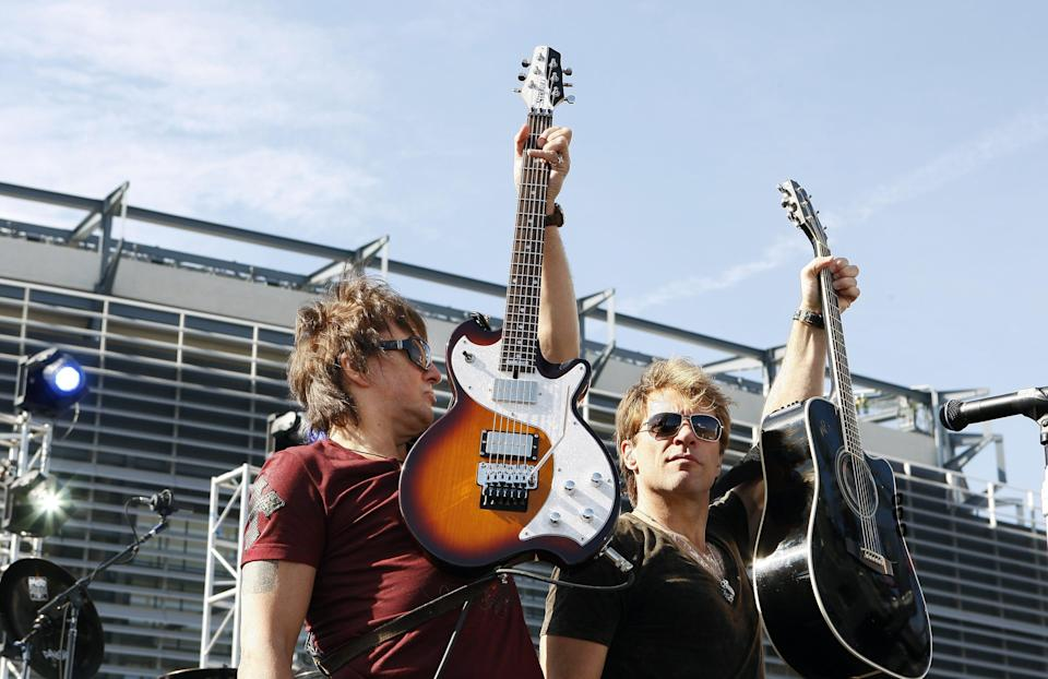 Richie Sambora, left, and Jon Bon Jovi perform Oct. 22, 2009, at an invitation-only performance for 5,000 fan club contest winners and construction workers in East Rutherford, N.J. The band announced a two-year world tour that would begin with a show at the new $1.6 billion Meadowlands football stadium, the first concert inside the venue.