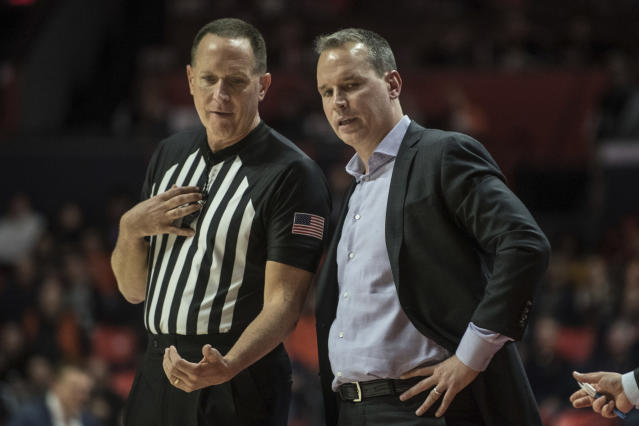 Northwestern Head Coach Chris Collins has a word with an official as his team takes on Illinois in the second half of an NCAA college basketball game, Saturday Jan. 18, 2020, in Champaign, Ill. (AP Photo/Holly Hart)