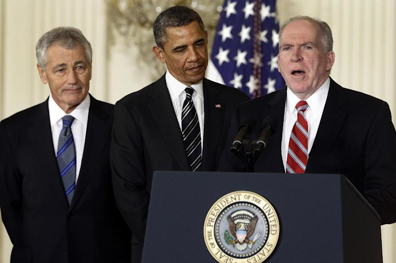 President Barack Obama and his choice for Defense Secretary, former Nebraska Sen. Chuck Hagel, left, listen as he choice for new CIA Director, current Deputy National Security Adviser for Homeland Security and Counterterrorism, John Brennan, speaks during the announcement in the East Room of the White House in Washington, Monday, Jan. 7, 2013 in Washington.  (AP Photo/Charles Dharapak)