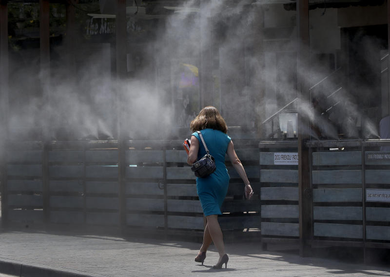 The Latest: Phoenix and Tucson tie heat records for the date