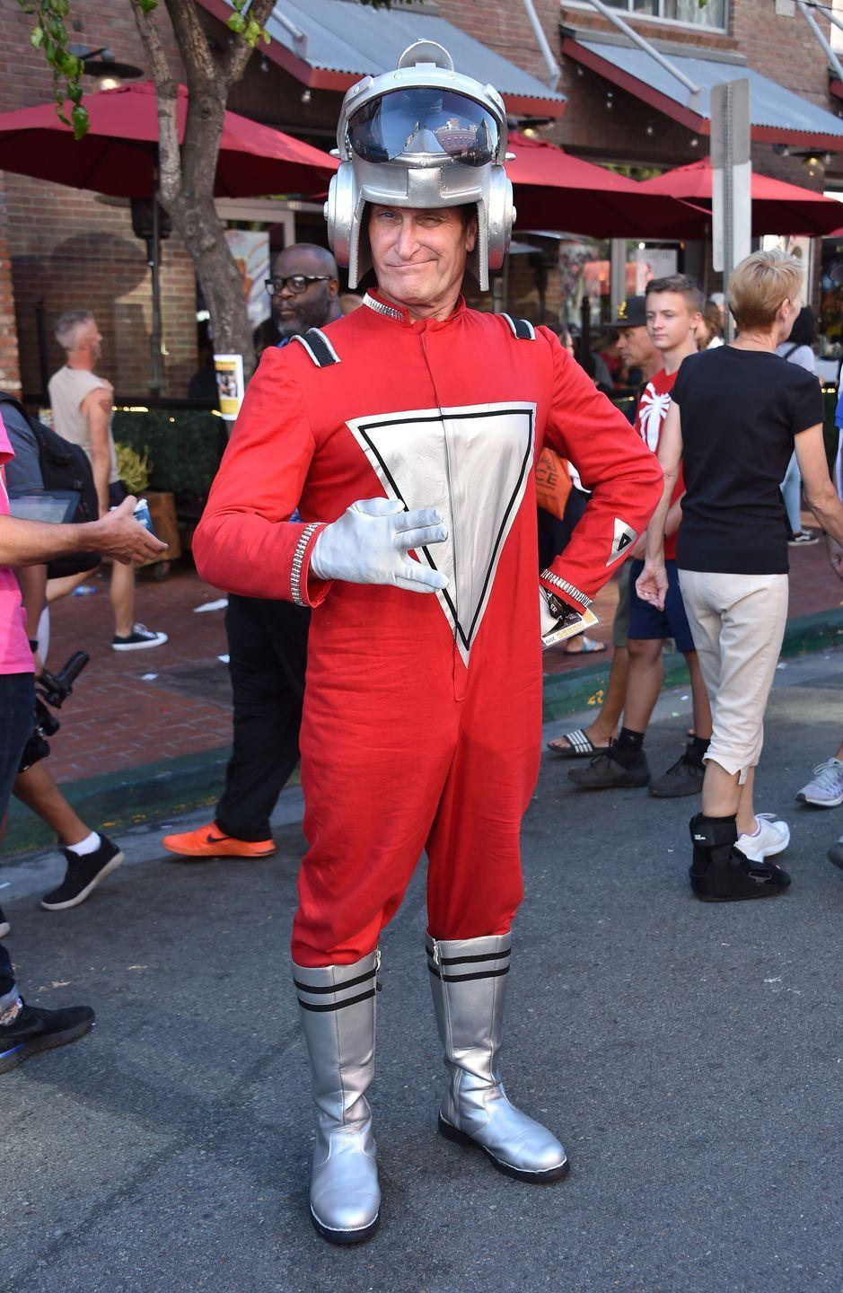 """<p>Take on Robin Williams' character Mork from Ork with a red jumpsuit and silver boots. </p><p><a class=""""link rapid-noclick-resp"""" href=""""https://www.amazon.com/Retro-Spaceman-Halloween-Costume-Shirt/dp/B07PGWKWHL?tag=syn-yahoo-20&ascsubtag=%5Bartid%7C10070.g.23122163%5Bsrc%7Cyahoo-us"""" rel=""""nofollow noopener"""" target=""""_blank"""" data-ylk=""""slk:SHOP RED SHIRT"""">SHOP RED SHIRT</a></p>"""