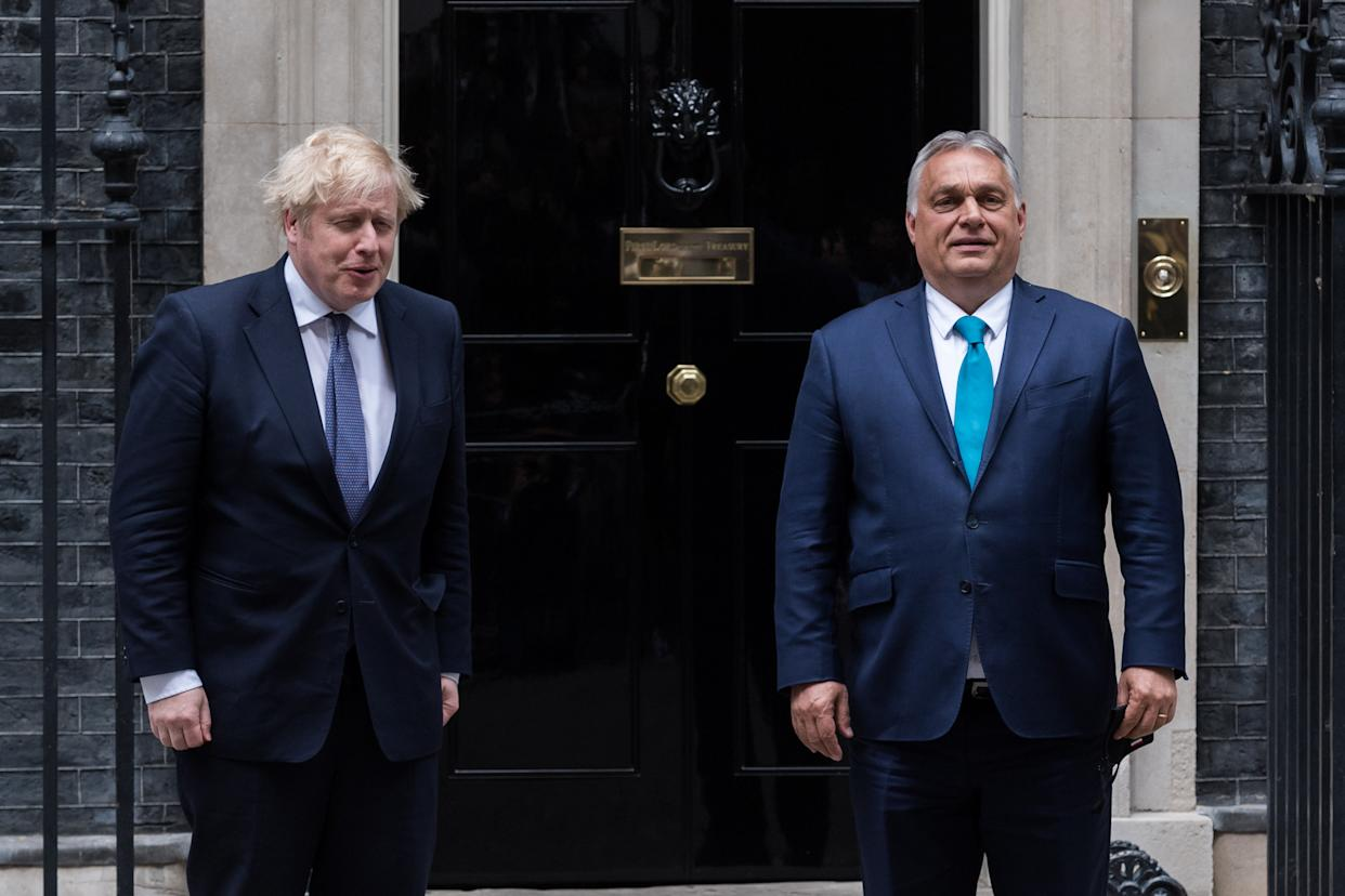 LONDON, UNITED KINGDOM - MAY 28, 2021: British Prime Minister Boris Johnson (L) welcomes Hungarian Prime Minister Viktor Orban (R) outside 10 Downing ahead of bilateral talks, on 28 May, 2021 in London, England. (Photo credit should read Wiktor Szymanowicz/Barcroft Media via Getty Images)