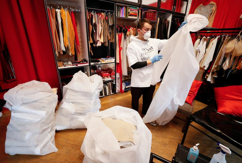 Ukrainian fashion designer Frolov inspects a medical protective coverall in his show room in Kiev