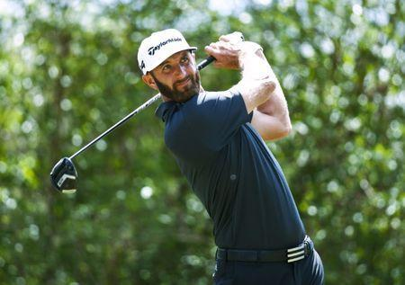 Mar 22, 2018; Austin, TX, USA; Dustin Johnson of the United States tees off on number 12 during the second round of the WGC – Dell Technologies Match Play golf tournament at Austin Country Club. Mandatory Credit: Erich Schlegel-USA TODAY Sports