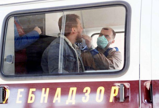PHOTO: A medic wearing a protective mask takes a swab from a man inside a mobile laboratory for coronavirus testing near Saint Petersburg's Pulkovo Airport, Russia March 23, 2020. (Anton Vaganov/Reuters, FILE)