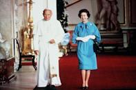 <p>Pope John Paul II, the head of the Catholic church, paid a visit to Buckingham Palace to meet with the Queen of England, who is the head of the church of England.</p>