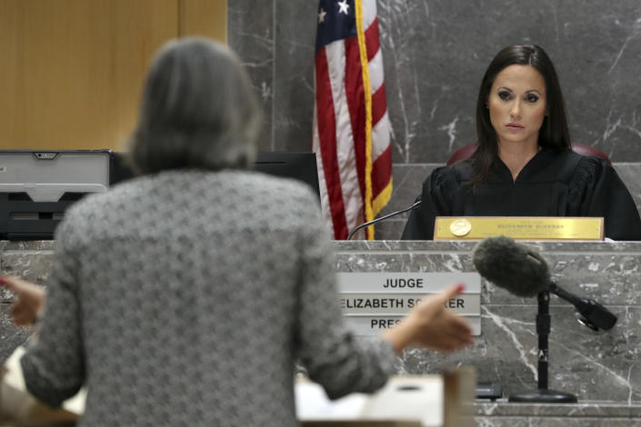 Judge Elizabeth Scherer looks towards Prosecutor Maria Schneider during a pre-trial hearing at the Broward County Courthouse in Fort Lauderdale, Fla., Wednesday, July 14, 2021, on four criminal counts stemming from Parkland school shooter Nikolas Cruz's alleged attack on a Broward jail guard in November 2018. Cruz is accused of punching Sgt. Ray Beltran, wrestling him to the ground and taking his stun gun. (Amy Beth Bennett/South Florida Sun-Sentinel via AP, Pool)