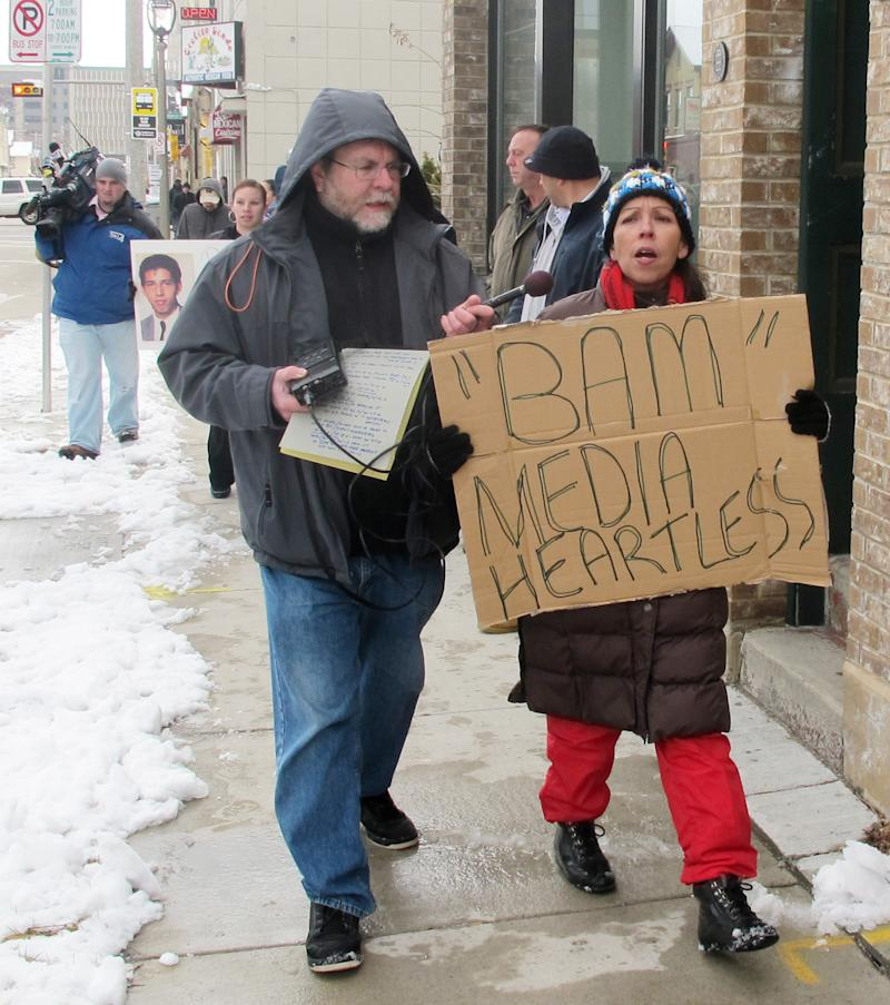 In this March 3, 2012 photo, Janie Hagen, right, protests in Milwaukee against Bam Marketing and Media, which is organizing a walking tour of bars where serial killer Jeffrey Dahmer hunted his victims. Hagen's brother, 25-year-old Richard Guerrero, disappeared in 1988 and was one of the first young men Dahmer is known to have murdered.  (AP Photo/Dinesh Ramde)