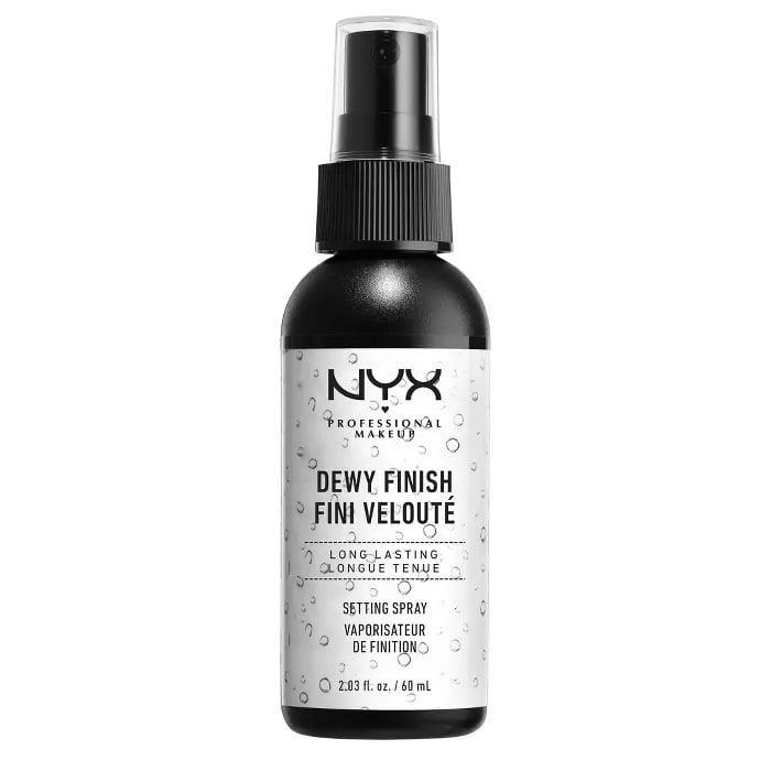 """<p>Lots of people grow dissatisfied with setting sprays because they are prone to soaking up excess moisture and oil. The <span>NYX Professional Makeup Dewy Finish Setting Spray</span> ($8) is ideal for those with dry complexions, as it keeps the skin hydrated but still keeps your makeup in place. It also contains powerhouse antiaging ingredient <a href=""""https://www.popsugar.com/beauty/best-niacinamide-skin-care-products-47606854"""" class=""""link rapid-noclick-resp"""" rel=""""nofollow noopener"""" target=""""_blank"""" data-ylk=""""slk:niacinamide"""">niacinamide</a>, which fades discoloration and brightens uneven tone.</p>"""