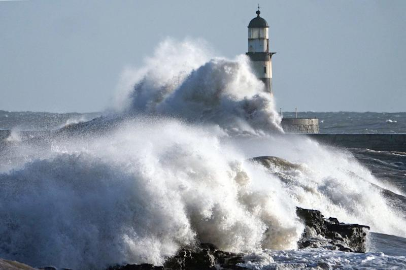 Waves crash against the pier wall at Seaham Lighthouse on the County Durham coast on Monday: PA