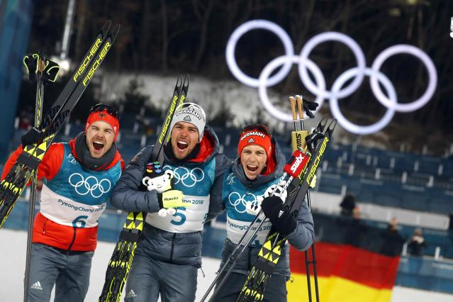 Nordic Combined Events - Pyeongchang 2018 Winter Olympics - Men's Individual 10 km Final - Alpensia Cross-Country Skiing Centre - Pyeongchang, South Korea - February 20, 2018 - Gold medalist Johannes Rydzek of Germany, silver medalist Fabian Riessle of Germany and bronze medalist Eric Frenzel of Germany celebrate during the victory ceremony. REUTERS/Kai Pfaffenbach