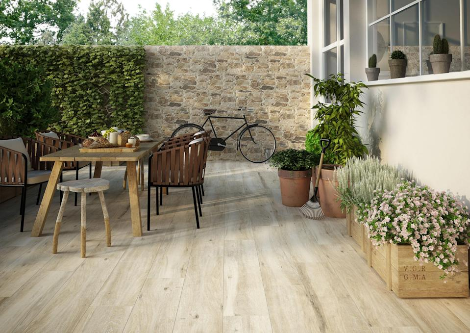 """<p>Already popular in interior design, wood-effect <a rel=""""nofollow noopener"""" href=""""http://www.housebeautiful.co.uk/decorate/floors/a1680/porcelain-tiles-flooring-tips/"""" target=""""_blank"""" data-ylk=""""slk:porcelain tiles"""" class=""""link rapid-noclick-resp"""">porcelain tiles</a> look set to become a trend in garden design, suggests designer John Wyer FSGD, who first used them two years ago on his award-winning garden at <a rel=""""nofollow noopener"""" href=""""http://www.housebeautiful.co.uk/chelsea-flower-show-rhs/"""" target=""""_blank"""" data-ylk=""""slk:RHS Chelsea"""" class=""""link rapid-noclick-resp"""">RHS Chelsea</a>. Hard-wearing, scratch, stain and heat-resistant, in 2018 we'll see them used for both flooring and cladding in a variety of patterns.</p><p><strong><em>BUY NOW: </em></strong><a rel=""""nofollow noopener"""" href=""""https://www.wallsandfloors.co.uk/parlor-wood-effect-tiles"""" target=""""_blank"""" data-ylk=""""slk:Parlor Wood Effect Tiles, Wallsandfloors.co.uk"""" class=""""link rapid-noclick-resp""""><strong><em>Parlor Wood Effect Tiles, Wallsandfloors.co.uk</em></strong></a></p>"""
