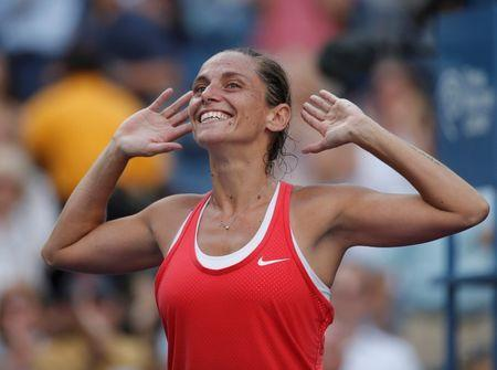 Roberta Vinci of Italy celebrates with the crowd after defeating Serena Williams of the U.S. in their women's singles semi-final match at the U.S. Open Championships tennis tournament in New York, September 11, 2015. REUTERS/Mike Segar Picture Supplied by Action Images