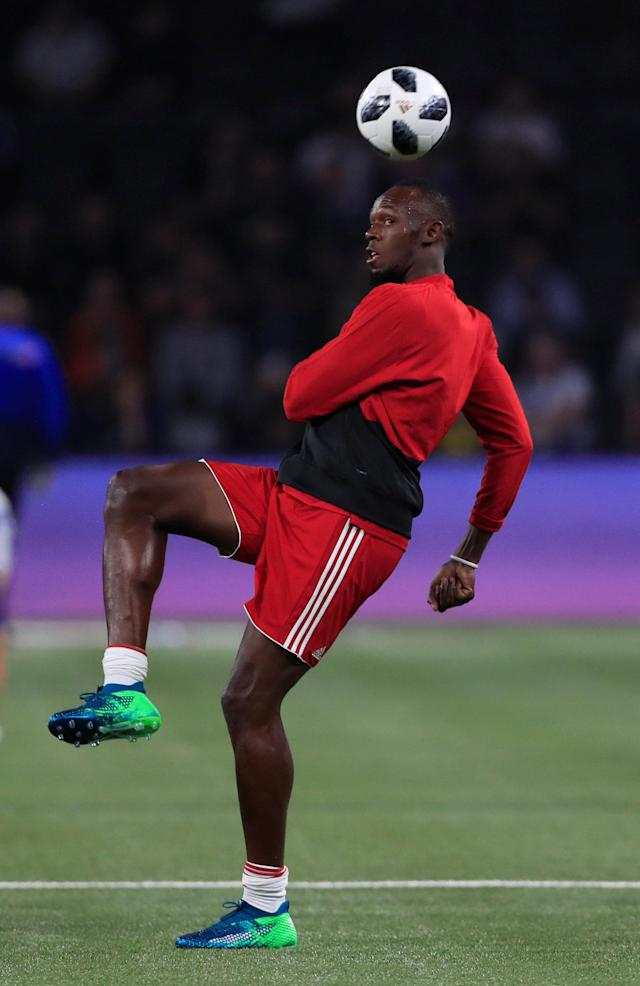 Soccer Football - France 98 v FIFA 98 Selection - U Arena Stadium, Nanterre, France - June 12, 2018 FIFA 98's Usain Bolt during warm up REUTERS/Gonzalo Fuentes
