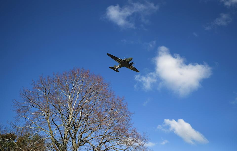 The C-47 Dakota, part of the Battle of Britain Memorial Flight which operates from RAF Coningsby in Lincolnshire, flies over the crematorium. (Photo: REUTERS / HANNAH MCKAY)
