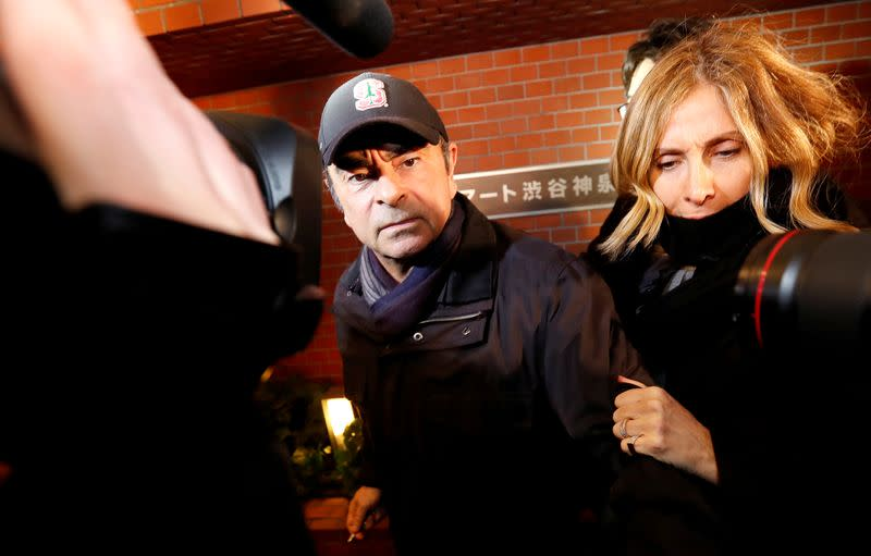 Former Nissan Motor Chairman Carlos Ghosn accompanied by his wife Carole Ghosn, arrives at his place of residence in Tokyo