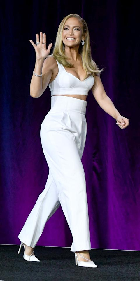 <p>The Super Bowl is still days away, but J.Lo is already breaking out some show-stopping outfits like this Alaïa set, which consisted of high-waisted pants and a bra-like crop top. Kenneth Jay Lane jewels made the look complete.</p>