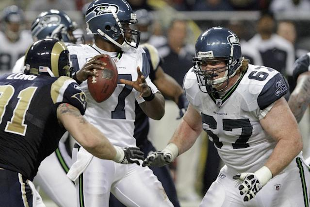 Seattle Seahawks guard Paul McQuistan (67) defends the Seattle Seahawks quarterback Tarvaris Jackson (7) during the third quarter of an NFL football game Sunday, Nov. 20, 2011, in St. Louis. (AP Photo/Seth Perlman)
