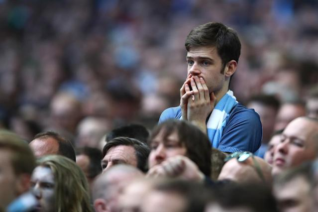 <p>Manchester City fans look on in angst as Arsenal steal a lead in extra-time </p>