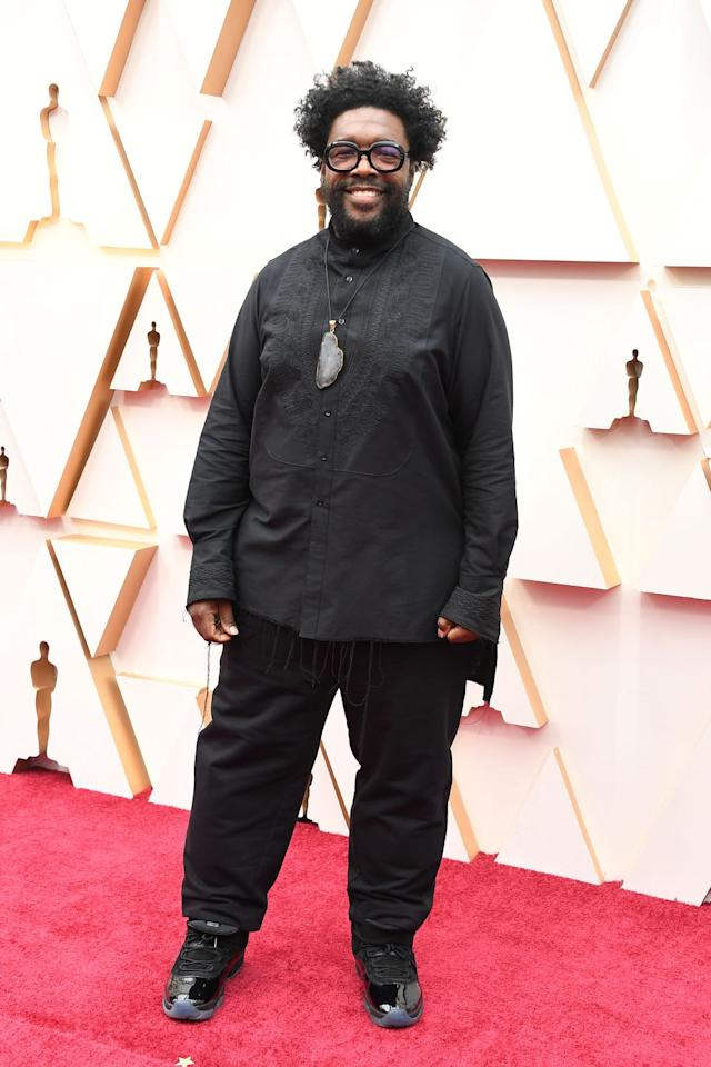 <p>The musician and writer went for an all-black look, accessorized with a stone pendant necklace and a pair of patent sneakers.</p>