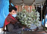 Vendor selling qat, a mild stimulant, waits for customers amid concerns of the spread of the coronavirus disease (COVID-19) at a market in Sanaa
