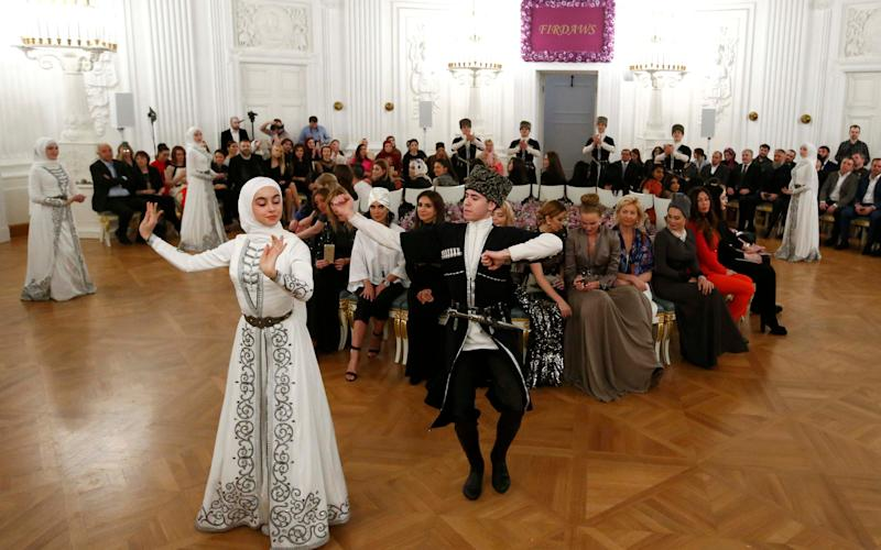 Dancers perform during a show of the Firdaws fashion house led by Aishat Kadyrova, daughter of the Chechen Republic head Ramzan Kadyrov - Credit: Reuters